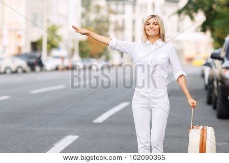 Nice woman standing near road
