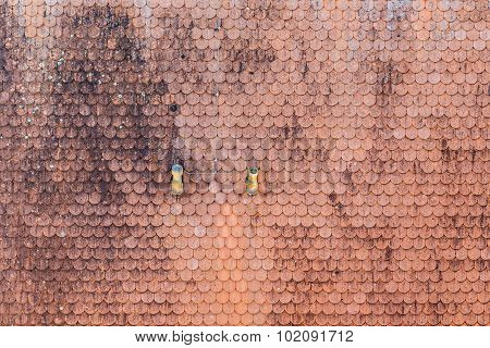Red Shingles At A Roof