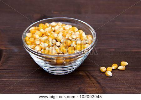 Maize grains dried on wood