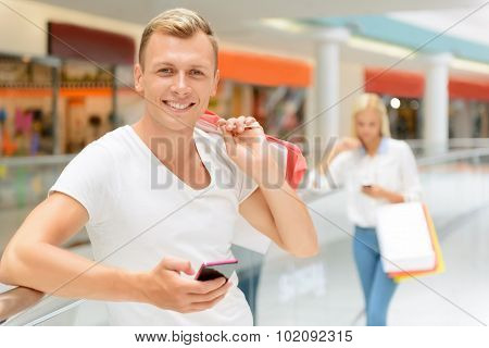 Handsome boy holding mobile phone