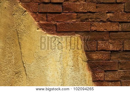 Old Damaged Brick Wall With Plaster