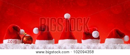Happy new year 2016 santa hats .Seven red santa hats .