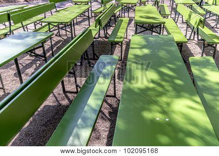 Detail Of Empty Beergarden Tables In The English Garden
