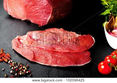 Fresh and raw meat. Still life of steaks ready for cooking, barbecue.