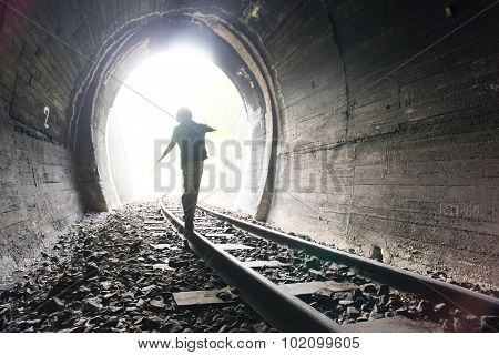 Child Walking In Railway Tunnel
