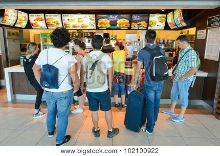 PRAGUE, CZECH REPUBLIC - AUGUST 04, 2015: McDonald's restaurant. McDonald's is the world's largest chain of hamburger fast food restaurants, founded in the United States in 1940