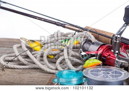 Fishing Tackles On Board With White Background