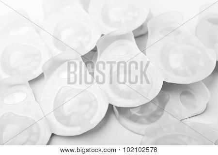 Several Packs Of Contact Lens On White Surface.