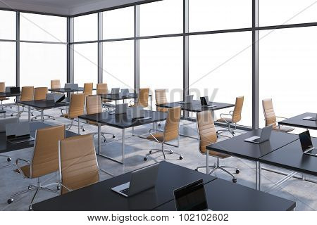 Workplaces In A Modern Corner Panoramic Office, Copy Space In The Windows. Open Space. Black Tables