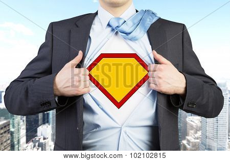 Businessman In A Suit Is Tearing The Shirt. Yellow Figure On The Chest As A Symbol Of The Power And