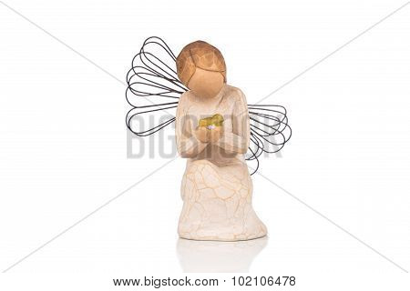 Decorative Figurine Of An Angel Praying On White Background.