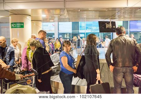 Moscow, Russia - September 16, 2015: Crowd Of Passengers Waiting To Pick Their Luggage At Baggage Co