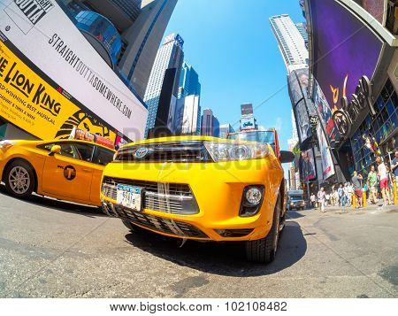 NEW YORK,USA - AUGUST 14,2015 : Yellow cabs and neon lights at Times Square in New York City