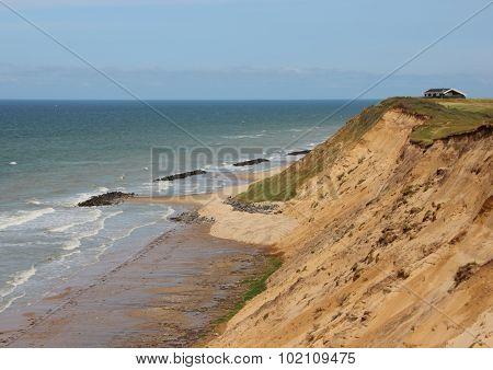 Sandy Cliff Landscape At Ocean And House Near Edge