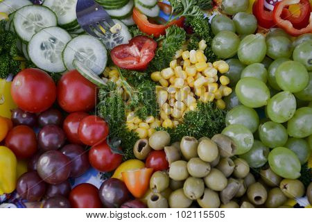 Fresh and colorful home-grown vegetables: peppers, tomato, corn, cucumber, olives, broccoli. Healthy