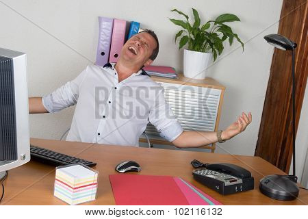 Man With His Arms Wide Open At Office