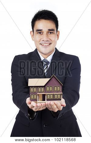 Businessman Showing Small House