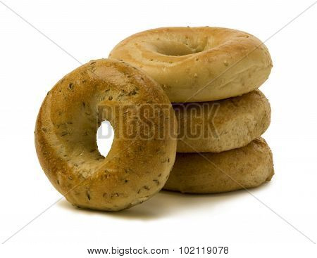 Stack Of Three Bagels With One Leaning On The Side