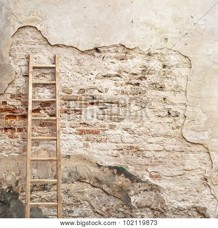 weathered stucco wall with wooden ladder