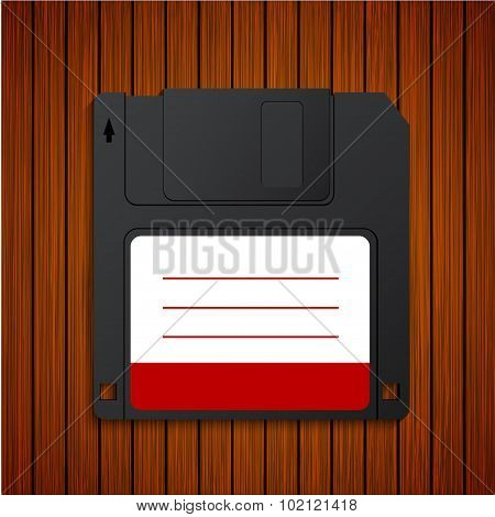 Vector modern diskette on wooden background