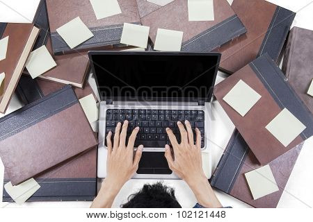 Male Learner Typing On Notebook Laptop
