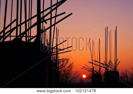 Armature From Concrete Columns At Sunset