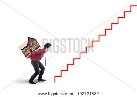 Male Worker Carrying House Model
