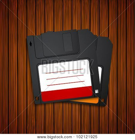 Vector modern diskette on wooden background.