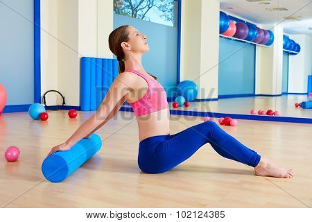 Pilates woman roller exercise workout at gym indoor
