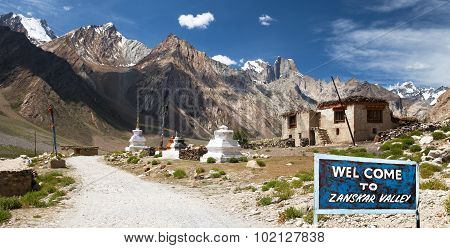 Village In Suru Valley And Signpost Welcome To Zanskar