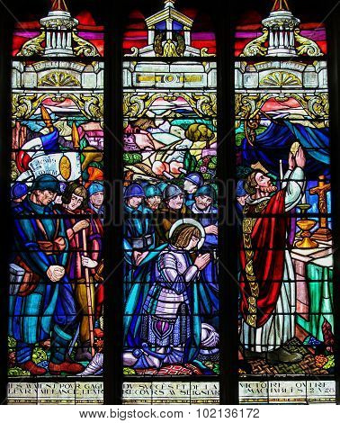Stained Glass Of French First World War Soldiers Praying With Jeanne D'arc