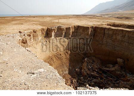 Landscape of sinkholes in the Dead Sea Israel.