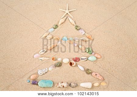 Beach Xmas Concept On Sand As A Christmas Tree With Shells