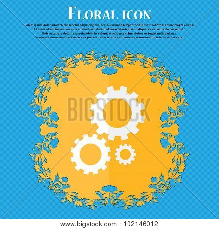 Cog Settings Sign Icon. Cogwheel Gear Mechanism Symbol. Floral Flat Design On A Blue Abstract Backgr