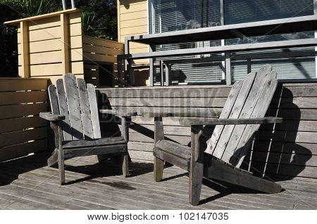 Summer home furniture in a bach garden on Waiheke Island New Zealand.