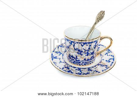 Classic luxury porcelain cup set and golden spoon, isolated on white background