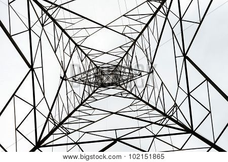 aerial view of a very huge and tall transmission tower against a white sky