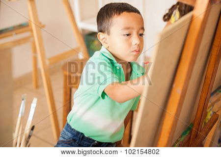 Little Boy Learning How To Paint