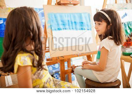 Girls Comparing Their Work