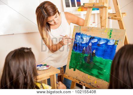 Art Teacher Helping A Student