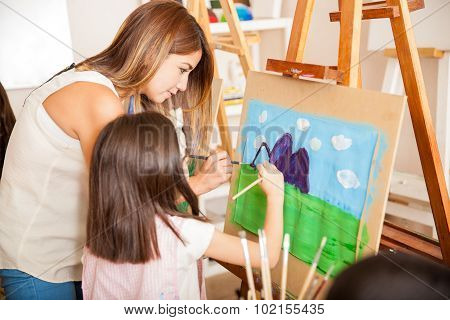 Teacher And Student Painting Together