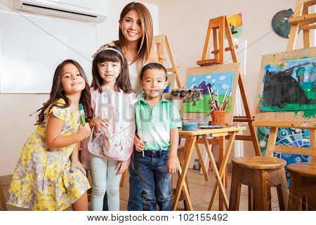 Art Class Teacher With Her Students