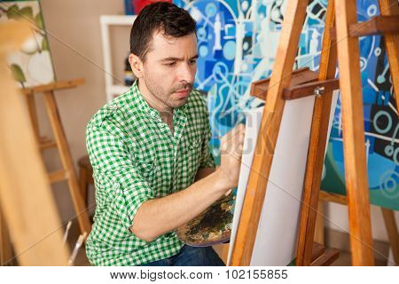 Handsome Artist Working On A Painting