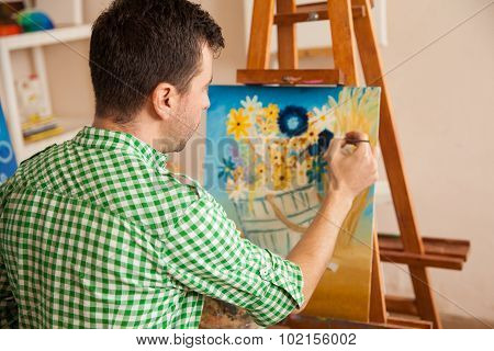 Young Male Artist At Work