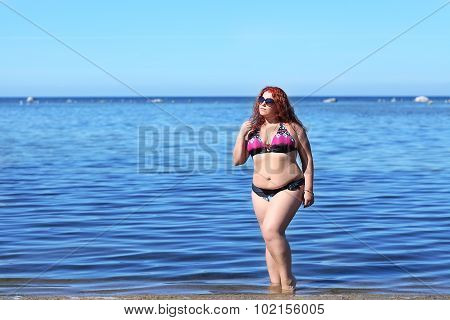 Red-haired Plus Size Woman Resting On Coast