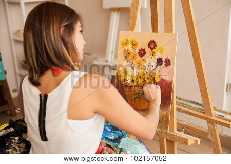Female Artist Painting Some Flowers