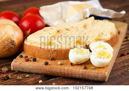 Quail Eggs And Bread With Butter And Cheese
