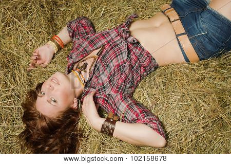 Cowgirl Lying On Hay In The Stable