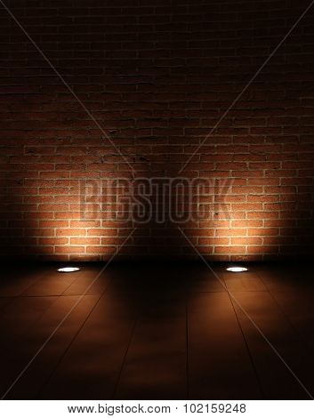 grunge interior room with brickwall lighted with spots.