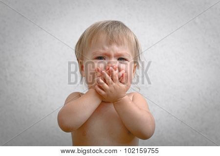 Screaming Crying Baby Covering Mouth By Hand